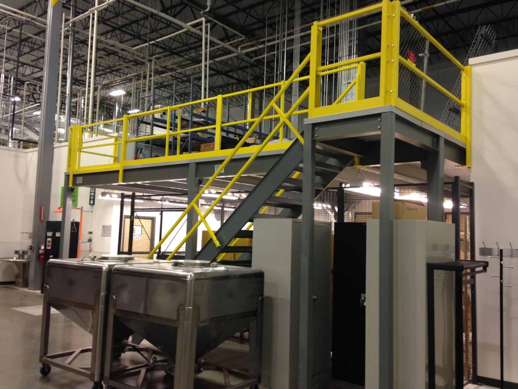 An industrial mezzanine work platform built by Porta-King